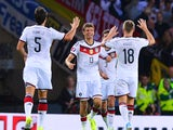 Thomas Muller of Germany celebrates scoring his teams opening goal with team mates during the UEFA EURO 2016 Qualifier Group D match between Scotland and Germany at Hampden Park on September 7, 2015 in Glasgow, Scotland.