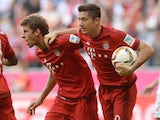 Thomas Muller and Robert Lewandowski celebrate Bayern's equaliser against Augsburg on September 12, 2015