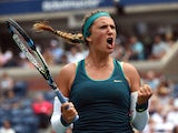 Victoria Azarenka of Belarus reacts against Simona Halep of Romania during their 2015 US Open Women's Singles - Quarterfinals at the USTA Billie Jean King National Tennis Center September 9, 2015
