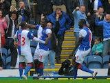 Blackburn Rovers' Nigerian forward Yakubu (2L) celebrates after scoring during the English Premier League football match between Blackburn Rovers and Arsenal at Ewood Park, Blackburn, north-west England on September 17, 2011