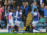 Blackburn Rovers' Nigerian forward Yakubu (2L) celebrates after scoring during the English Premier League football match between Blackburn Rovers and Arsenal at Ewood Park, Blackburn, north-west England on September 17, 2011