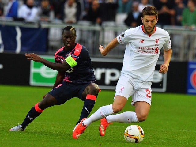 Bordeaux's French Senegalese forward Henri Saivet (L) vies with Liverpool's midfielder Adam Lallana (R) during the UEFA Europa League Group B football match Bordeaux vs Liverpool on September 17, 2015 at the Matmut Atlantique stadium in Bordeaux.