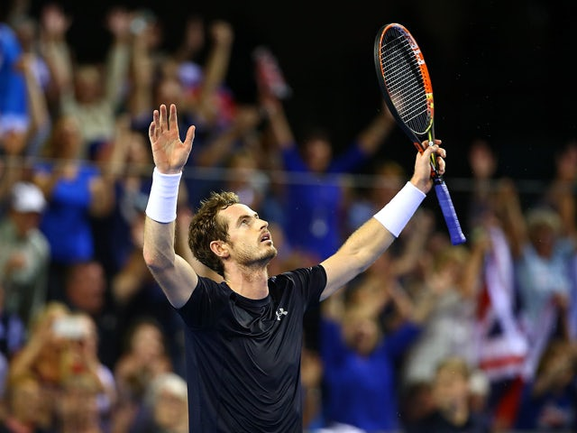 Andy Murray of Great Britain celebrates victory in his match against Bernard Tomic of Australia during Day Three of the Davis Cup Semi Final match between Great Britain and Australia at Emirates Arena on September 20, 2015