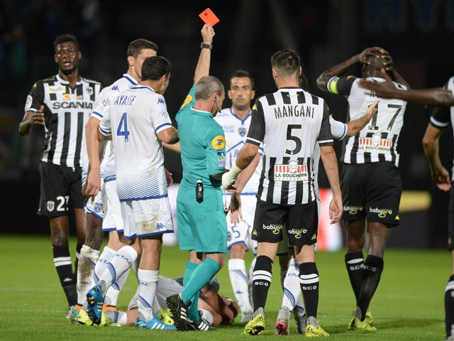 French referee Lionel Jaffred gives a red card to Angers' Senegalese midfielder Cheikh N'Doye (R) during the French L1 football match between Angers and Troyes on September 19, 2015