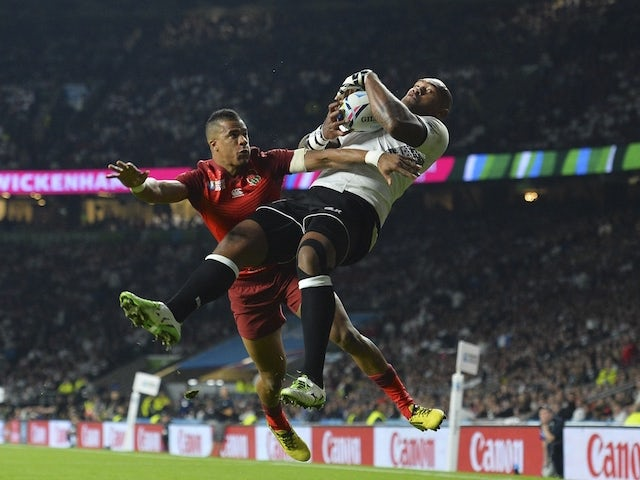 England's winger Anthony Watson (L) and Fiji's winger Nemani Nadolo jump for the ball during a Pool A match of the 2015 Rugby World Cup between England and Fiji at Twickenham stadium in south west London on September 18, 2015.