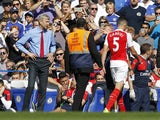 Arsenals French manager Arsene Wenger (L) reacts after the sending off of Arsenals Brazilian defender Gabriel (R) during the English Premier League football match between Chelsea and Arsenal at Stamford Bridge in London on September 19, 2015