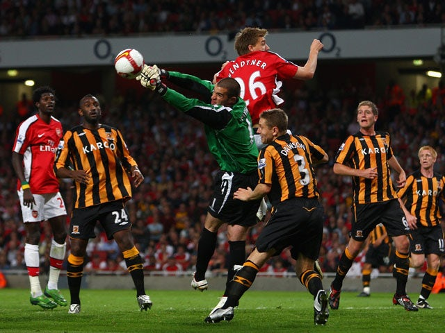 Goalkeeper Boaz Myhill of Hull City punches the ball clear from Nicklas Bendtner of Arsenal during the Barclays Premier League match between Arsenal and Hull City at the Emirates Stadium on September 27, 2008