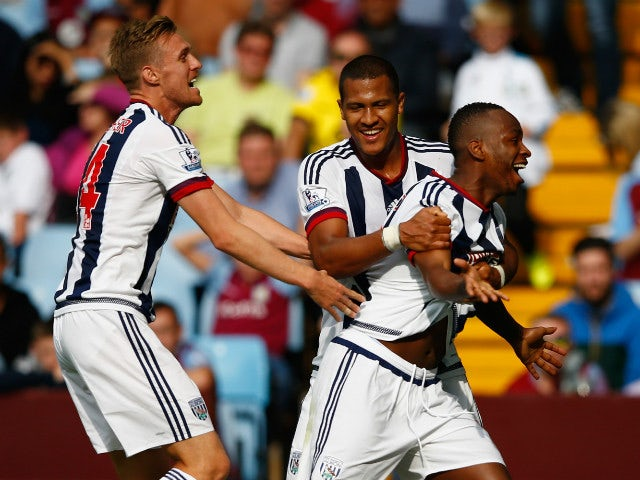Saido Berahino (R) of West Bromwich Albion celebrates scoring his team's first goal with his team mates Darren Fletcher (L) and Salomon Rondon (C) during the Barclays Premier League match between Aston Villa and West Bromwich Albion at Villa Park on Septe