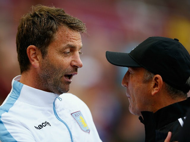 Tim Sherwood Manager of Aston Villa and Tony Pulis manager of West Bromwich Albion greet prior to the Barclays Premier League match between Aston Villa and West Bromwich Albion at Villa Park on September 19, 2015 in Birmingham, United Kingdom