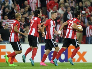 Athletic Bilbao's forward Aritz Aduriz (R) celebrates with midfielder Oscar De Marcos (2ndR) and teammates after scoring during the UEFA Europa League group L football match Athletic Club Bilbao vs FC Ausburg at the San Mames stadium in Bilbao on Septembe