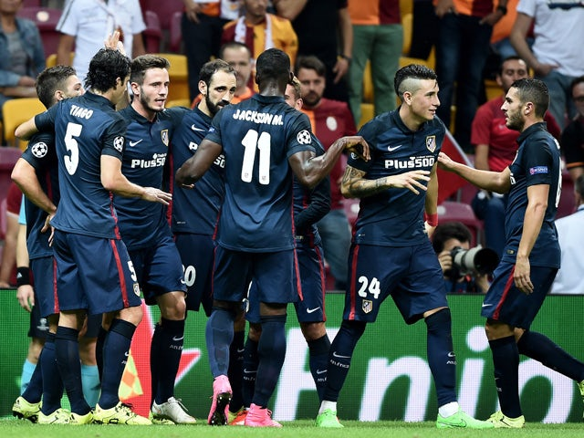 Atletico Madrid's Antoine Griezmann (3rdL) celebrates with his team mates after scoring the second goal during the Champions League group C football match Galatasaray vs Atletico Madrid on September 15, 2015