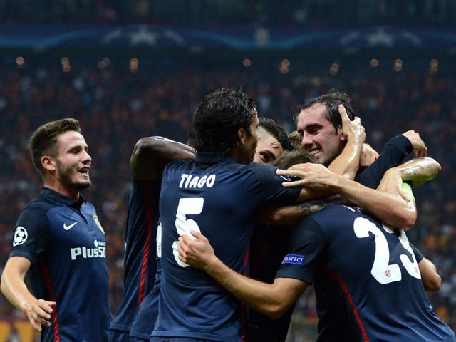 Atletico Madrid's Antoine Griezmann celebrates with his team mates after scoring the second goal during the Champions League group C football match Galatasaray vs Atletico Madrid on September 15, 201
