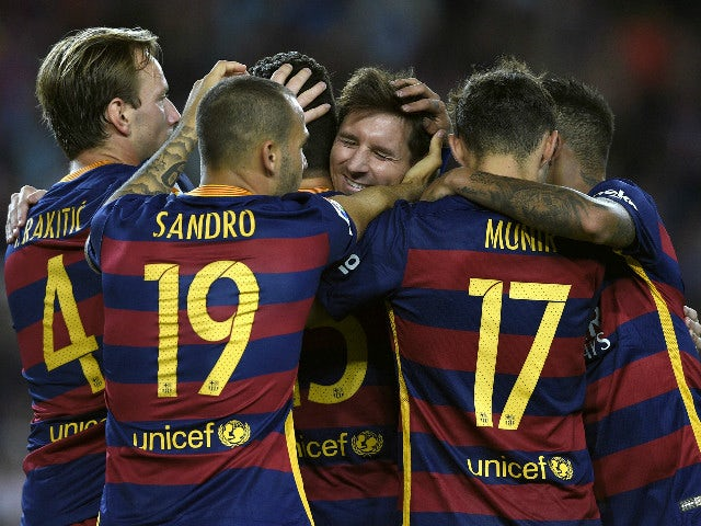 Barcelona's defender Marc Bartra (hidden) celebrates with Barcelona's Argentinian forward Lionel Messi (C) and teammates after scoring during the Spanish league football match FC Barcelona vs Levante UD at the Camp Nou stadium in Barcelona on September 20