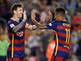 Barcelona's Argentinian forward Lionel Messi (L) celebrates with Barcelona's Brazilian forward Neymar da Silva Santos Junior after scoring a goal on a penalty kick during the Spanish league football match FC Barcelona vs Levante UD at the Camp Nou stadium