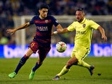 Barcelona's defender Marc Bartra (L) vies with Levante's Algerian forward Nabil Ghilas during the Spanish league football match FC Barcelona vs Levante UD at the Camp Nou stadium in Barcelona on September 20, 2015.