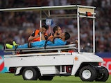 Rafinha of FC Barcelona is injured during the UEFA Champions League Group E match between AS Roma and FC Barcelona at Stadio Olimpico on September 16, 2015