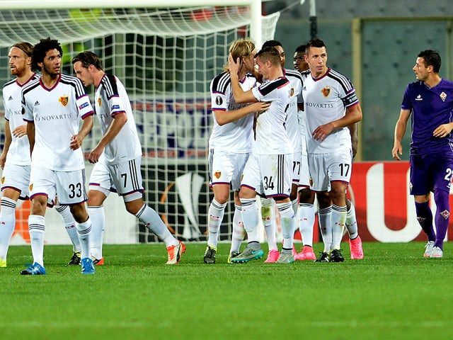 Basel's midfielder Birkir Bjarnason (C) celebrates with teammates after scoring a goal during the UEFA Europa League football match between Fiorentina and Basel on September 17, 2015