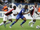 Bastia's French midfeilder Floyd Ayite (C) vies with Nice's French midfielder Nampalys Mendy (L) during the French L1 football match Bastia (SCB) against Nice (OGCN) on September 19, 2015