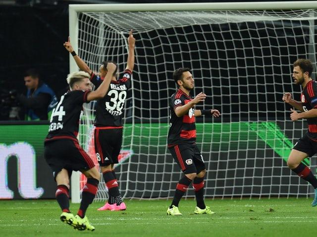 Leverkusen's Swiss forward Admir Mehmedi and his teammates celebrate scoring the opening goal during the UEFA Champions League group E first leg football match between Bayer 04 Leverkusen and FC Bate Borisov in Leverkusen, western Germany on September 16,