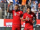 Bayern Munich's Chilean midfielder Arturo Vidal (L) celebrates scoring during the German first division Bundesliga football match SV Darmstadt 98 vs FC Bayern Munich, in Darmstadt, southern Germany on September 19, 2015