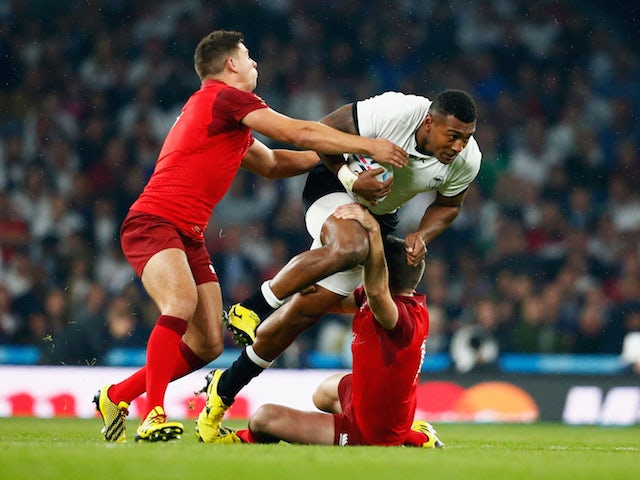 Ben Youngs (L) and George Ford of England tackle Waisea Nayacalevu of Fiji during the 2015 Rugby World Cup Pool A match between England and Fiji at Twickenham Stadium on September 18, 2015 in London, United Kingdom.