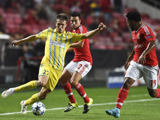 Astana's forward Baurzhan Dzholchiyev (L) vies with Benfica's Argentinian midfielder Nico Gaitan (C) and Benfica's defender Eliseu Santos (R) during the UEFA Champions League football match SL Benfica vs FC Astana at the Luz stadium in Lisbon on September