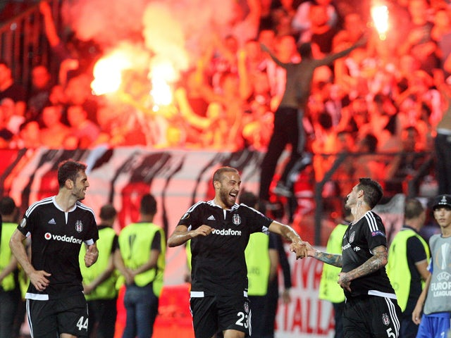 Besiktas' players celebrate after scoring during the UEFA Europa League Group H football match between KF Skenderbeu and Besiktas JK at the Elbansan Arena in Elbasan on September 17, 2015