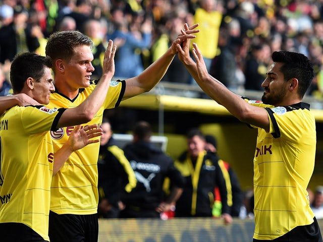 Dortmund's midfielder Jonas Hofmann (L), Dortmund's midfielder Ilkay Guendogan (R) and Dortmund's defender Matthias Ginter (2nd L) celebrate after scoring the 1-0 during the German first division Bundesliga football match Borussia Dortmund vs Bayer Leverk