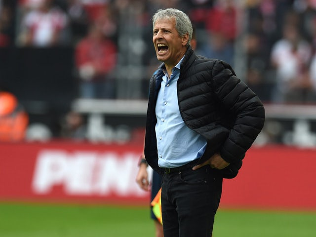 Monchengladbach's Swiss head coach Lucien Favre reacts during the German first division Bundesliga football match FC Cologne vs Borussia Monchengladbach in Cologne, western Germany on September 19, 2015