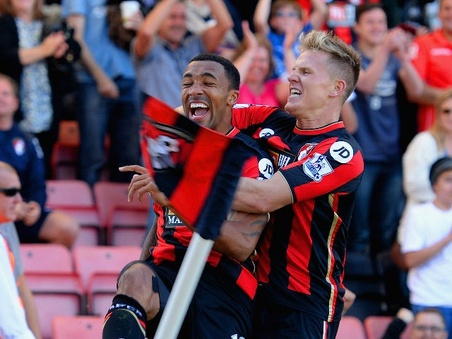Callum Wilson (L) of Bournemouth celebrates scoring his team's first goal with his team mate Matt Ritchie (R) during the Barclays Premier League match between A.F.C. Bournemouth and Sunderland at Vitality Stadium on September 19, 2015 in Bournemouth, Unit
