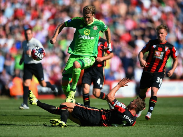 Ola Toivonen of Sunderland is tackled by Simon Francis of Bournemouth during the Barclays Premier League match between A.F.C. Bournemouth and Sunderland at Vitality Stadium on September 19, 2015 in Bournemouth, United Kingdom.