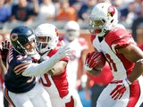 David Johnson #31 of the Arizona Cardinals returns the opening kickoff for a touchdown against the Chicago Bears as Stepfan Taylor #30 of the Arizona Cardinals blocks Bryce Callahan #37 of the Chicago Bears during the first quarter at Soldier Field on Sep