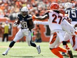 Melvin Gordon #28 of the San Diego Chargers attempts to run past Carlos Dunlap #96 and Dre Kirkpatrick #27, both of the Cincinnati Bengals, during the first quarter at Paul Brown Stadium on September 20, 2015 in Cincinnati, Ohio.