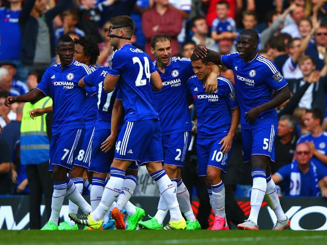 Eden Hazard (2nd R) of Chelsea celebrates scoring his team's second goal with his team mates during the Barclays Premier League match between Chelsea and Arsenal at Stamford Bridge on September 19, 2015