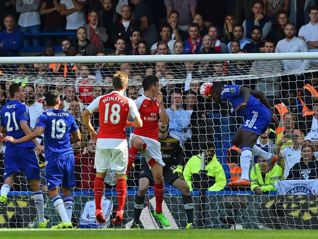Chelsea's French defender Kurt Zouma heads the opening goal of the English Premier League football match between Chelsea and Arsenal at Stamford Bridge in London on September 19, 2015