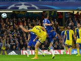 Maccabi Tel Aviv's Israeli defender Yuval Shpungin vies against Chelsea's Brazilian-born Spanish striker Diego Costa as he shoots to score the team's third goal during the UEFA Champions League, group G, football match between Chelsea and Maccabi Tel Aviv