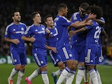 Chelsea's English defender Gary Cahill and Chelsea's English midfielder Ruben Loftus-Cheek (3R) congratulate Chelsea's Brazilian midfielder Willian (R) for scoring a goal during the UEFA Champions League, group G, football match between Chelsea and Maccab