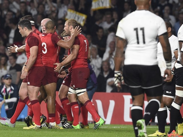 England's flanker and captain Chris Robshaw (C) celebrates a penalty try with teammates during a Pool A match of the 2015 Rugby World Cup between England and Fiji at Twickenham stadium in south west London on September 18, 2015.