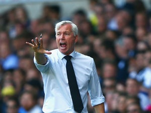 Alan Pardew manager of Crystal Palace gives instructions as Mauricio Pochettino manager of Tottenham Hotspur looks on during the Barclays Premier League match between Tottenham Hotspur and Crystal Palace at White Hart Lane on September 20, 2015