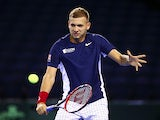 Dan Evans of Great Britain plays a backhand during a practice session at Emirates Arena on September 17, 2015