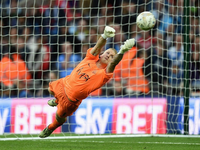 Daniel Bentley of Southend saves the final penalty in the shoot out to win the Sky Bet League Two Playoff Final match between Southend United and Wycombe Wanderers at Wembley Stadium on May 23, 2015 in London, England.
