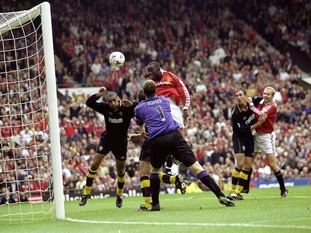 Dwight Yorke of Manchester United scores during the FA Carling Premiership match against Southampton played at Old Trafford in Manchester, England. The game ended in a 3-3 draw.