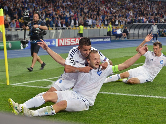 Oleh Husev of FC Dynamo Kiev celebrates with teammates after scoring during the UEFA Champions league group G football match between FC Dynamo Kiev and FC Porto at Olimpiysky stadium in Kiev on September 16, 2015