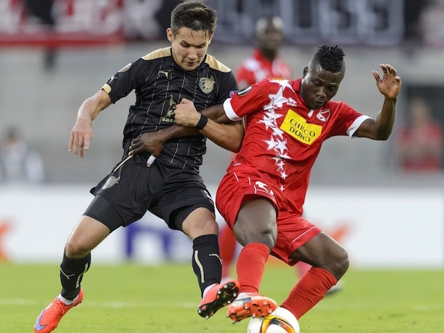 Sion's Ghanaian forward Ebenezer Assifuah (L) vies with FC Rubin Kazan's Russian defender Elmir Nabiullin during the UEFA Europa League group B football match between FC Sion and FC Rubin Kaza on September 17, 2015, at the Tourbillon stadium in Sion.
