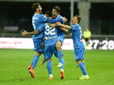 Leandro Paredes of Empoli FC is mobbed by team mates after scoring his team's first goal during the Serie A match between Udinese Calcio v Empoli FC at Stadio Friuli on September 19, 2015