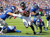 Tevin Coleman #26 of the Atlanta Falcons runs the ball past Mark Herzlich #94 and Uani' Unga #47 of the New York Giants for a first quarter touchdown at MetLife Stadium on September 20, 2015 in East Rutherford, New Jersey.