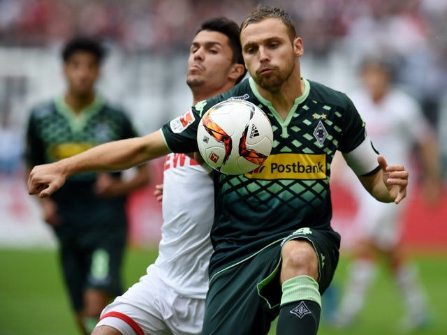Cologne's midfielder Leonardo Bittencourt and Moenchengladbach's defender Tony Jantschke (R) vie for the ball during the German first division Bundesliga football match 1 FC Cologne vs Borussia Moenchengladbach, in Cologne, western Germany on September 19