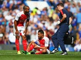 Francis Coquelin sits injured during the game between Chelsea and Arsenal on September 19, 2015