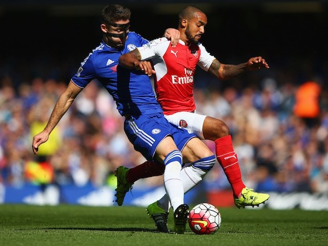 Gary 'Bane' Cahill and Theo Walcott battle for the ball during the game between Chelsea and Arsenal on September 19, 2015