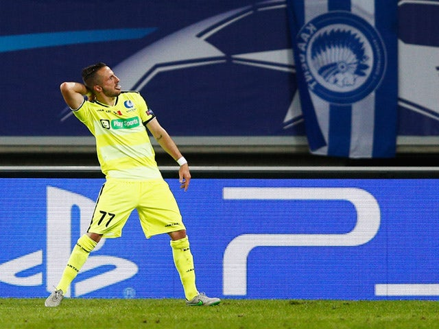 Danijel Milicevic of Gent celebrates scoring his teams first goal of the game during the UEFA Champions League Group H match between KAA Gent and Olympique Lyonnais held at Ghelamco Arena on September 16, 2015